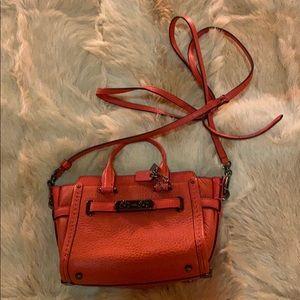 Coach mini purse.